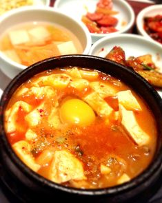 Sundubu (순두부) has to be my favorite food. Spicy, (somewhat?) healthy, delicious. And that egg!
