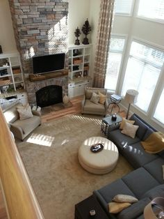 Sectional + round sofa/center piece. Like this arrangement with the sectional and two chairs by the fire.