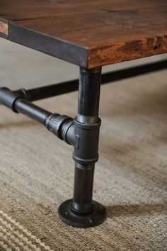 Since my adjustable coffee table dining table doesn't exist, I may have to by an butterfly leaf table, then replace the base with pipes like this to make it coffee table height. Then when I want it dining height, tip it on its side, screw four more leg extensions in and tip it back up.