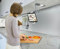 Kitchen Mount Stand for iPad. This tablet stand mounts to the underside of a kitchen cabinet, and is perfect when you need recipes. Ipad Wall Mount, Tablet Mount, Ipad Tablet, Ipad Pro, Cool Kitchen Gadgets, Kitchen Tools, Cool Kitchens, Kitchen Ideas, Smart Kitchen