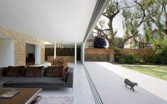 Architect: Found Associates / Photographer: Hufton & Crow / Product: Vitrocsa sliding doors with invisible frame / Partner: Vitrocsa Minimal UK