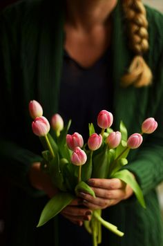 Hands holding Tulips
