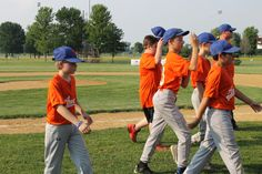Ben Bappe, far left, and the rest of his team head into the dugout to begin Monday's little league game. Photo by Sarina Rhinehart/Ames Tribune  http://amestrib.com/news/little-leaguer-triumphs-over-fear