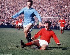 A rare colour picture from the 1960s above, with Manchester City favourite Mike Summerbee challenged by United's David Sadler.