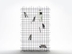 Scatter Shelf is a storage unit composed of 5mm black acrylic shelves arranged in a grid form, stacked in three layers and slightly displaced. The resulting shelving unit is not only structurally strong, but also creates a visual effect in which the objects placed on the shelves appear as though they are caught in a spider's web when viewed from the front. Pretty cool to look at it from the different angles!
