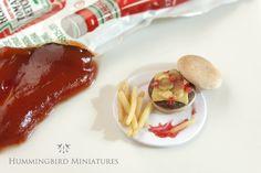 Mini hamburger and fries with ketchup.