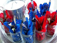 Bandana Mason Jars  Fill mason jars for your guests to drink out of with all-american bandanas for napkins and silverware. It's a tidy and patriotic way to get everyone what they need.