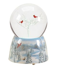 "From the Winter Wonderland Collection Glitterdome features a pair of red cardinal birds perched upon a snow covered tree Sits atop a base with a winter village scene Winds up to play the tune: ""Winter Wonderland""Dimensions: x x Globe dim"