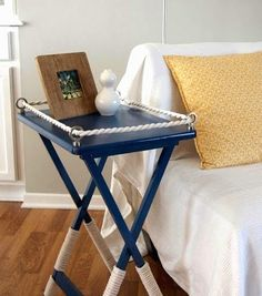 Cute little side table makeover with paint and rope: http://www.completely-coastal.com/2014/06/coastal-nautical-furniture-makeover-wicker-chair-table-dresser.html
