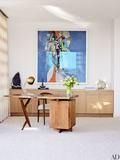 An artwork by George Condo overlooks a 1972 George Nakashima desk in a corner of the master bedroom | archdigest.com