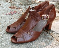 A 1920's/1930's style with a unique wide T-strap and intricate perforated details. - Leather uppers and leather soles - Whole and half sizes, 5 ½-11 (Runs long - order a half size smaller) - Medium wi
