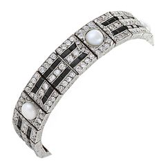 Lacloche Freres Art Deco, Diamond, Onyx, Pearl and Platinum Bracelet. A French Art Deco platinum bracelet with diamond, onyx, and pearl by Lacloche Frères. The bracelet has 256 old European-cut diamonds with an approximate total weight of 9.50 carats, 64 calibre-cut onyx and 5 natural pearls (not tested). With original box. Circa 1920's.