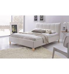 Magnifique lit adulte ornera votre chambre avec son design contemporain, sa structure en bois revêtu en cuir blanc, ses pieds en bois naturel, et son tête d...