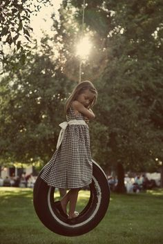 Tire Swing wearing her dress