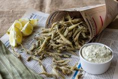 Fried Smelt with Tartar Sauce.  Add all of the ingredients for the coating in a resealable bag (fit for food). Shake to combine. 	Add the fish in batches. Seal bag and shake to coat. 	Remove fish from bag...