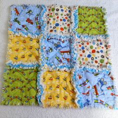 CIJ Sale 15% Boy Rag Blanket- Blue, Green, Red, & Yellow Toys Quilt christmasinjuly. $18.70, via Etsy.