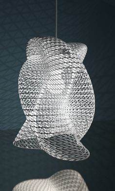 3d printed lampshade by studioluminaire.com. The form was extracted of a script. Main components are sine() and cosine() functions, which gives the form a fluidity. Changing some of the parameters mean the shape to morph. The model is watertight, it's ready for 3D printing.