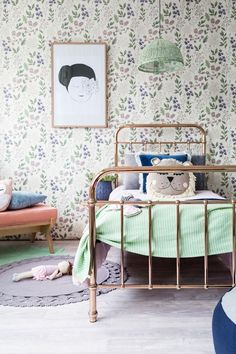 Classic, stylish kids bedroom. I especially love the floral wallpaper, copper and mint accents, and wicker light shade.