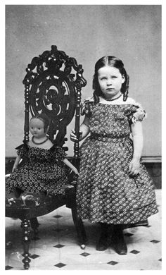Oh, this is a lovely child with her doll photo. matching dresses and curls! http://izannahwalker.files.wordpress.com/2012/02/girl-and-my-izannah1.jpg