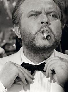 """Orson Welles With Cigar 4  by Terry O'Neill  American actor Orson Welles (1915 - 1985) on the set of the James Bond spoof 'Casino Royale' smoking a cigar, 1967.  Limited Edition Silver Gelatin Signed and Numbered  12"""" x 16"""" / 16"""" x 20""""  20"""" x 24"""" / 20"""" x 30""""  24"""" x 34"""" / 30"""" x 40""""  40"""" x 60"""" / 48"""" x 72""""  For questions or prices please contact us at info@igifa.com  IGI FINE ART"""