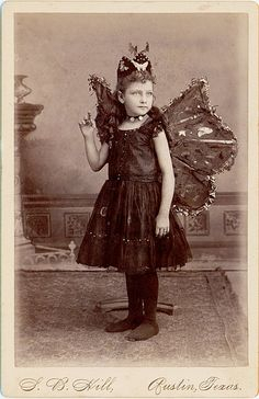 I think it would be cool to print and frame old photos like this in order to use them as home decor, even if the subject is not a relative they would still spark conversation and add some real interest to a room.    Butterfly Girl (Cabinet Card)    S. B. Hill of Austin, Texas has photographed this fairy child in a dark dress and tights with butterfly wings. The base of the photographer's headrest sits behind her feet.