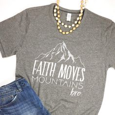 "Super soft tee with a vintage white design. Looking for the Toddler Version? FIT: Unisex... but runs big. ""Faith Moves Mountains Bro"""