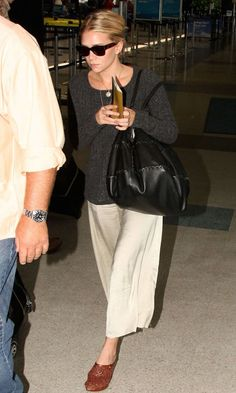 Ashley at LAX airport in a grey sweater and cropped wide leg pants, 2009. Get the look: +...
