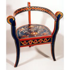Three legged chair painted in the Agder style.