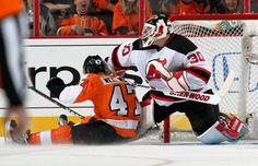 APRIL 29: Eric Wellwood #47 of the Philadelphia Flyers slides into goaltender Martin Brodeur #30 of the New Jersey Devils in Game One of the Eastern Conference Semifinals during the 2012 NHL Stanley Cup Playoffs on April 29, 2012 at the Wells Fargo Center in Philadelphia, Pennsylvania. (Photo by Len Redkoles/NHLI via Getty Images)