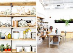 Wall of pipe-and-wood shelving over concrete floors at the Bash, Please studio