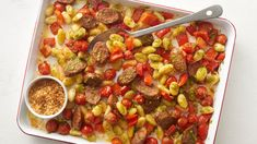 A tasty combination of gnocchi, tomatoes, red bell pepper and spicy Italian sausage are roasted on a sheet pan and tossed with basil pesto before serving.