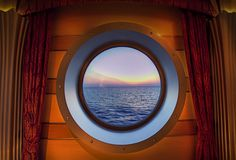 On  my cruise, my bed had a port hole above it just like this. Beautiful to look out at night.