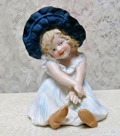 Darling Heubach Bonnet Girl Figurine from joan-lynetteantiquedolls on Ruby Lane