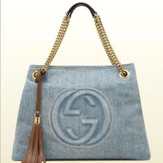 "Nwt Gucci soho 100% AUTHENTIC BRAND NEW GUCCI BAG   MADE IN ITALY    MEASUREMENT (approximately):  15"" L x 11"" H x 5"" D, handle drop: 8""  Materials:  blue denim, antique gold hardware Features:  blue denim with brown leather detail antique gold hardware natural cotton linen lining embossed interlocking G detail detachable leather tassel double chain shoulder straps with leather shoulder pad 18cm drop inside hook closure interior zip pocket Come with original dust bag Takes a week to ship…"