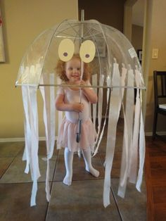 This jellyfish costume would be cute and easy to make for some kind of ocean-related performance.  (It would be easy to make an octopus with an umbrella, too.)