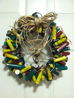 shotgun shell wreath...add lights! :) I must make this for my brother for Christmas. Last year I gave him buckshoot shell lights for his tree.  He needs this for his door.
