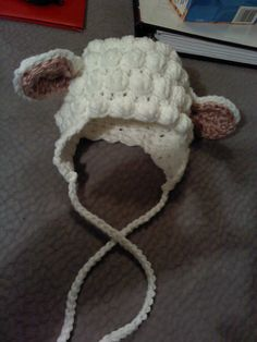 o-3 month crochet lamb hat I made. free pattern may or may not be on my crochet board.