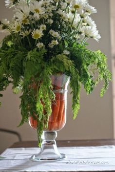 Carrots aren't just finger food — place the veggies in a clear vase along with white flowers for an extra pop of color. Get the tutorial from Alicia Hutchinson »
