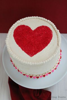 This Valentine's Day Red and Pink Velvet Cake is so good! The inside is of the cake is alternating layers of yummy pink and red velvet!
