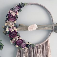 Salvaged silk dried flower dreamcatcher  - 15 inches wide - 34 inches long - light antique mauve salvaged silk - dried roses and greenery - driftwood - spiderweb design in branch - extra large rose quartz stone