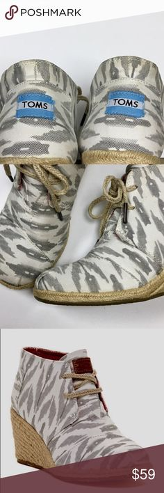 "TOMS Ikat Desert Wedge Bootie Used in Excellent Condition/ No Trades/ No PayPal/ Smoke & Pet Free Home/ Offers welcome/ Please Ask Questions About This Item/ see pic 4 for signs of wear, pic 3 is a stock photo  Details Sizing: True to size.  - Round toe with pleated detail - Lace-up vamp - Allover print - Topstitched detail - Suede insole - Espadrille wedge heel - Approx. 3.5"" shaft height - Approx. 2.75"" heel - Imported Materials Textile upper,suede insole, manmade sole TOMS Shoes Wedges"