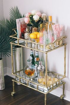 Want to add a bar cart to your home but don't know where to start? You've come to the right place! Bar carts are a huge trend that we are certainly on board with, but it can be hard to find out exactly what to add to your bar cart or how to even start… Diy Bar Cart, Gold Bar Cart, Bar Cart Styling, Bar Cart Decor, Event Styling, Bar Trolley, Drinks Trolley, Cocktail Trolley, Plywood Furniture