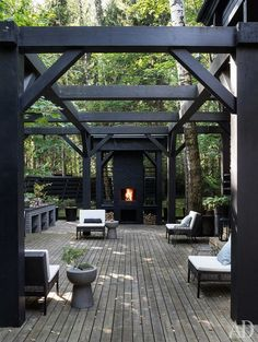 10 Unique And Stunning Pergola Design With Dark Rustic Style Outdoor Spaces One of the most attractive and well-liked outdoor structures today is the dark wood pergola. This kind of pergola can blend beautifully with your pati. Diy Pergola, Pergola Metal, Black Pergola, Pergola Carport, Pergola Swing, Pergola Shade, Pergola Kits, Pergola Ideas, Metal Roof