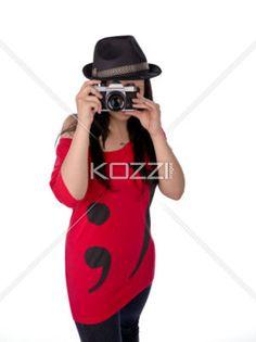 old camera - A photographer uses a film camera to take photos