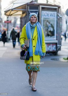 Elisa Nalin wearing a yellow coat and baby blue scarf and hat outside Hermes during the Paris Fashion Week Womenswear Fall/Winter 2016/2017 on March 7, 2016 in Paris, France.