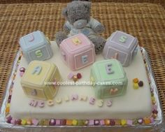 Homemade Baby Blocks Cake: I made this Baby Blocks cake for my Godson's Christening. I baked a large sheet cake of yellow cake from scratch and also a 13x9 sheet cake to cut up and