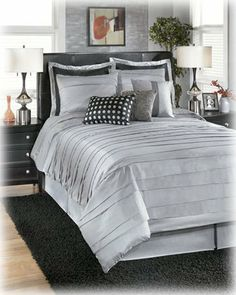 """Silver/Black Queen TOB Bedding Set - Signature Design by Ashley Furniture by Ashley. $196.42. 9 pc TOB ensemble. 1 - Comforter. 2 - Euro Shams. 1 - Skirt. 2 - Standard Shams. 9 pc TOB ensemble. 1 - Comforter. 1 - Skirt. 2 - Euro Shams. 2 - Standard Shams. 3 - Accent pillows. DRY CLEAN ONLY. Dimensions:Inches: 92""""W x 96""""D 19.61 2336.8mm W x 2438.4mm D x More Dimensions: Euro Shams (3) 26""""W x 26""""D Skirt 78""""W x 80""""D x 17""""H Standard Shams (2) 36""""W x 20""""D Some assem..."""