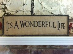 It's a Wonderful Life sign. Burlap black frame - window display during the holidays to match the theme