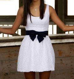 white dress with black bow belt