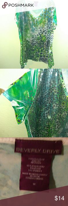 NWOT---Plus Size Sequined Tunic/Top NWOT-- Never worn. Pics do not do this item justice. Size 1x, V-neck, shark bite type bottom & made by Beverly Drive. 95% Polyester & 5% Spandex blend. Slinky & lightweight. Great for everyday, or jazz it up for a holiday gathering.Teal with different shades of green with animal-like prints & circles. Sequins adorn the front, to accent the patterns. Feel free to ask any questions. Beverly Drive Tops
